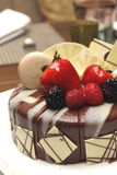 Delicious chocolate strawberry cake with chocolate ganache. Stock Photography
