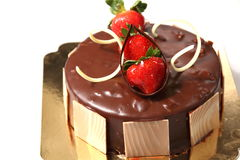 Delicious chocolate strawberry cake stock photography