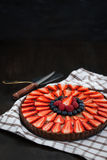 Delicious chocolate tart decorated with fresh berries Stock Image
