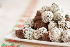 Delicious chocolate truffels. Delicious home made chocolate truffels with white and dark chocolate flakes Stock Image