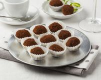 Chocolate truffles. Delicious chocolate truffles served on a coffee table royalty free stock photography
