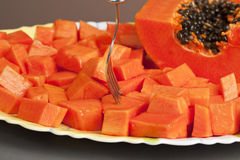 Delicious Chopped Papaya Fruit. With a fork royalty free stock image