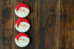Delicious Christmas cookies with Santa Claus face. On a wooden table Stock Image