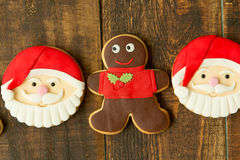 Delicious Christmas cookies with Santa Claus face. On a wooden table Royalty Free Stock Photography