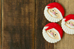 Delicious Christmas cookies with Santa Claus face. On a wooden table Stock Images
