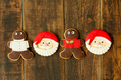 Delicious Christmas cookies with Santa Claus face. On a wooden table Royalty Free Stock Images