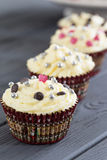 Delicious Christmas Day Chocolate Cupcakes with Beautiful Decoration on Dark Wooden Background, Vertical Stock Images