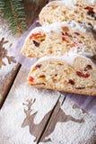 Delicious Christmas fruit bread Stollen closeup vertical Royalty Free Stock Photo
