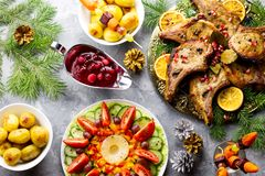 Christmas dinner with roasted meat steak, Christmas Wreath salad, baked potato, grilled vegetables, cranberry sauce stock photo