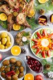 Christmas dinner with roasted meat steak, Christmas Wreath salad, baked potato, grilled vegetables, cranberry sauce. stock images