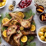 Christmas dinner with roasted meat steak, Christmas Wreath salad, baked potato, grilled vegetables, cranberry sauce royalty free stock image
