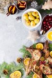 Christmas dinner with roasted meat steak, Christmas Wreath salad, baked potato, grilled vegetables, cranberry sauce. Delicious Christmas meal with roasted meat royalty free stock photo