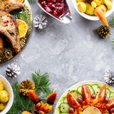 Christmas dinner with roasted meat steak, Christmas Wreath salad, baked potato, grilled vegetables, cranberry sauce. Delicious Christmas meal with roasted meat stock images