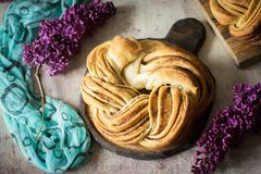 Delicious cinnamon bun for Breakfast on beautiful background. royalty free stock photo