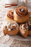 Delicious cinnamon rolls close up on a plate and coffee. vertica Stock Photography