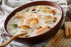 Delicious clam chowder soup with shellfish and bacon close-up on. A in a bowl on the table. horizontal Royalty Free Stock Image