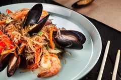Delicious close up view on Chinese noodles with mussels. stock image