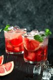 Delicious close up view on red fresh alcoholic cocktail from cranberries. royalty free stock photography