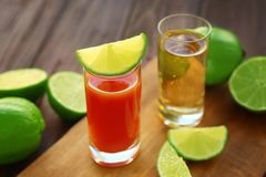 Delicious cocktail with tequila in shot glasses. On table Royalty Free Stock Photos