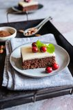 Cocoa cake with cranberries and marzipan glaze royalty free stock photography