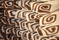 Delicious coconut biscuit roulade with chocolate cream Royalty Free Stock Image