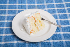 Delicious Coconut Cake on Blue Towel Royalty Free Stock Photography
