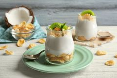 Delicious coconut cream in jar. On wooden background Royalty Free Stock Photo