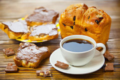 Delicious coffee with bread and chocolate paste on wooden Stock Images