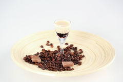 Delicious coffee cocktail with coffee beans and chocolate. In studio Stock Images