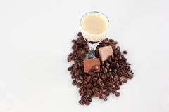 Delicious coffee cocktail with coffee beans and chocolate. In studio Stock Photos