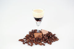 Delicious coffee cocktail with coffee beans and chocolate. In studio Royalty Free Stock Photo