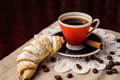 Delicious coffee with croissant,a cup of coffee and croissants w. Ith coffee beans and cinnamon sticks,breakfast with cup of coffee, croissants and chocolate Royalty Free Stock Images