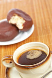Delicious coffee with donuts Stock Photography