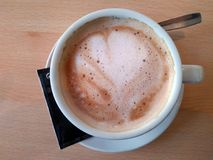 A delicious coffee with milk. Is waiting for you to enjoy it Royalty Free Stock Image