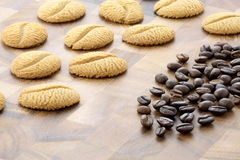 Delicious coffee shortbreads and coffee beans Stock Photography