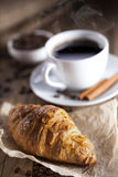 Delicious coffee with sweets on a wooden table Royalty Free Stock Images