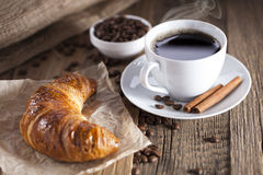 Delicious coffee with sweets on a wooden table Royalty Free Stock Photos
