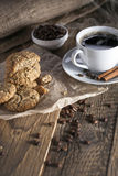 Delicious coffee with sweets on a wooden table Stock Images