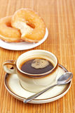Delicious coffee and two donuts Royalty Free Stock Photography