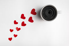 Delicious coffee for valentine's day. Path of red hearts leads to a hot cup of coffee Stock Photo