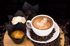 Delicious coffee and various cupcake and muffins on wooden tray. Stock Image