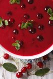 Delicious cold cherry soup in a bowl macro. vertical top view Stock Image