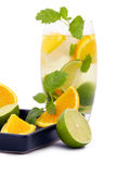 Delicious cold cocktail, fruit and mint ice. Royalty Free Stock Photo
