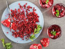 Fresh pomegranate juice in glass cups royalty free stock photo