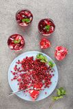 Cold pomegranate juice with ice cubes royalty free stock image