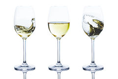 Delicious cold wine rippling and waving in glass Stock Images
