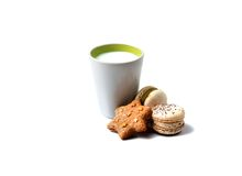 Delicious colored macaroons and cooky with milk Stock Images