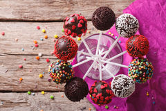 Delicious colorful cake pops in a glass. Horizontal top view Royalty Free Stock Photos