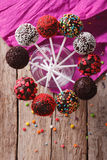 Delicious colorful cake pops in a glass. vertical top view Stock Photography