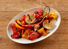Delicious colorful hot spicy roast vegetables royalty free stock photos